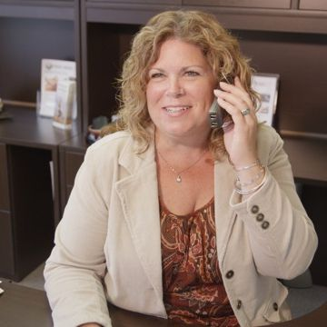 Maureen on the phone at her desk