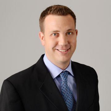 Head and torso shot of CEO Ryan Ellis