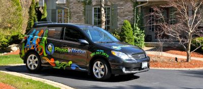 Physio In Motion car in front of client home