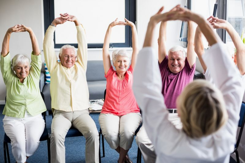 Group of happy seniors exercising