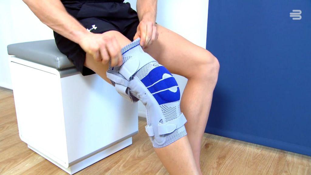 Patient doning a genutrain knee brace